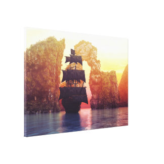 A pirate ship off an island at a sunset canvas print