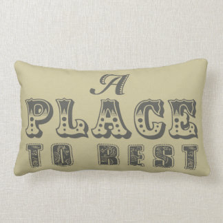 A Place to rest throw pillow in sand and mocha