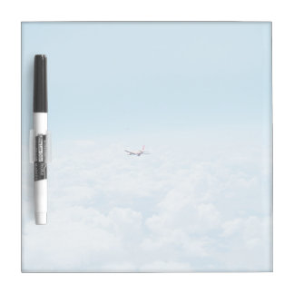 A plane flies about the clouds Dry-Erase boards