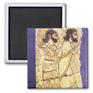 A plaque depicting two men walking 2 inch square magnet