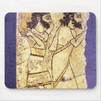 A plaque depicting two men walking mouse pad