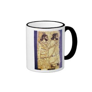 A plaque depicting two men walking ringer coffee mug