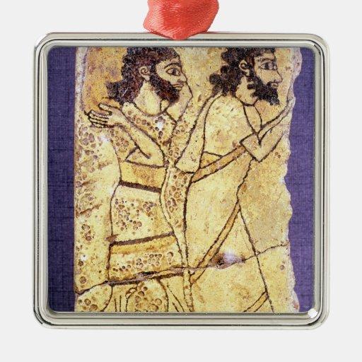A plaque depicting two men walking square metal christmas ornament
