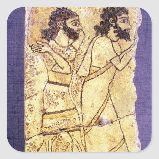 A plaque depicting two men walking square sticker