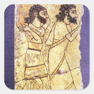 A plaque depicting two men walking square sticker