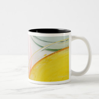 A plastic gloved hand sampling from petrie Two-Tone coffee mug