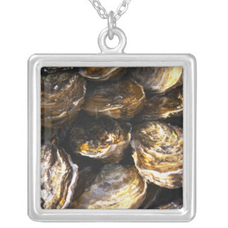 A plate of oysters. square pendant necklace