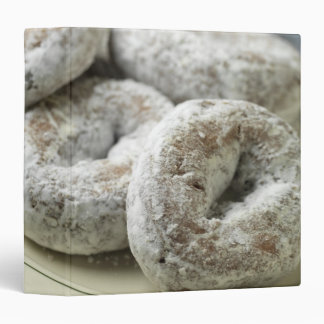 A plate of sugar donuts binder