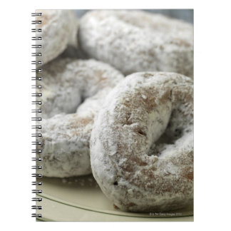 A plate of sugar donuts notebooks