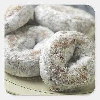A plate of sugar donuts square sticker