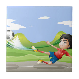 A player playing soccer at the street ceramic tiles