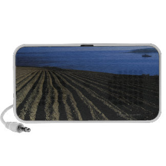 a ploughed field near the sea travel speaker