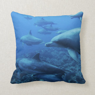 A POD OF DOLPHINS SWIMMING PILLOW