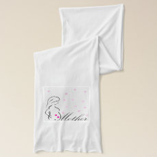 A pregnant mother-to-be with miniature pink hearts scarf