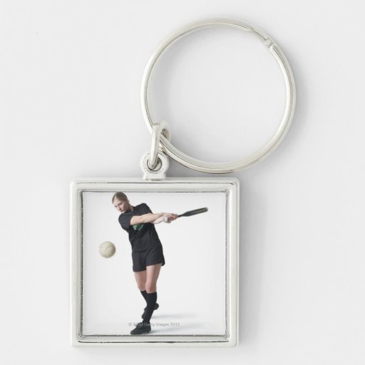 a pretty young caucasian woman is wearing a key chains