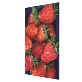 a punnet of ripe fresh strawberries for sale in canvas print