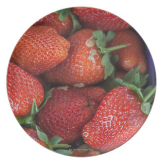 a punnet of ripe fresh strawberries for sale in party plate