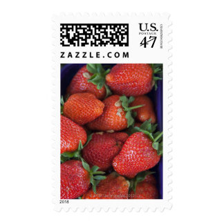 a punnet of ripe fresh strawberries for sale in postage