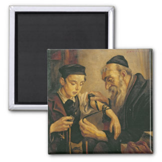 A Rabbi tying the Phylacteries to the arm of a boy 2 Inch Square Magnet