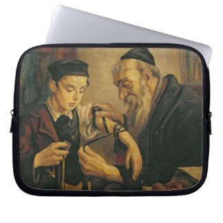 A Rabbi tying the Phylacteries to the arm of a boy Laptop Computer Sleeves