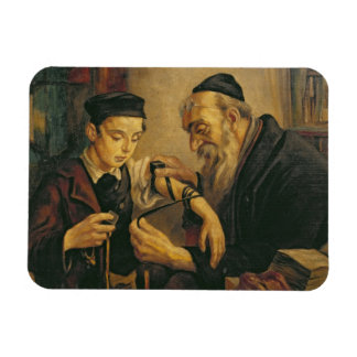A Rabbi tying the Phylacteries to the arm of a boy Rectangular Photo Magnet