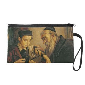 A Rabbi tying the Phylacteries to the arm of a boy Wristlet Purse