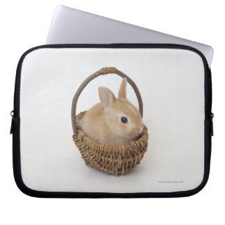 A rabbit is in a basket.Netherland Dwarf. Computer Sleeve