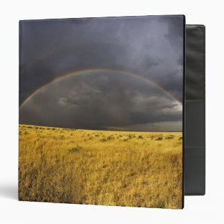 A rainbow appearing through a misty after noon vinyl binder