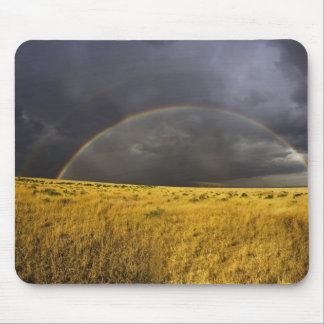 A rainbow appearing through a misty after noon mouse pad