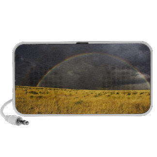 A rainbow appearing through a misty after noon notebook speakers