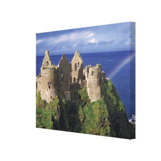 A rainbow strikes medieval Dunluce Castle on Canvas Print