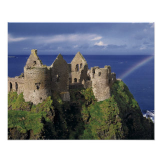A rainbow strikes medieval Dunluce Castle on Poster