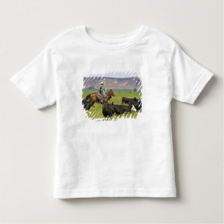 A rancher on horseback during a cattle roundup 2 toddler t-shirt