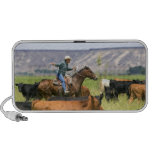 A rancher on horseback during a cattle roundup laptop speaker