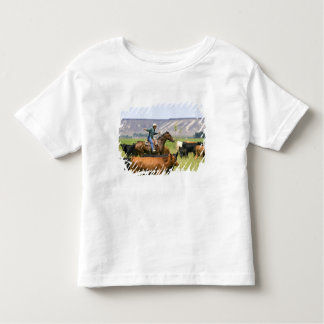 A rancher on horseback during a cattle roundup toddler t-shirt