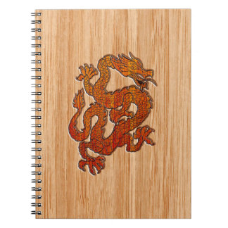 A red Dragon on Bamboo like Spiral Notebooks