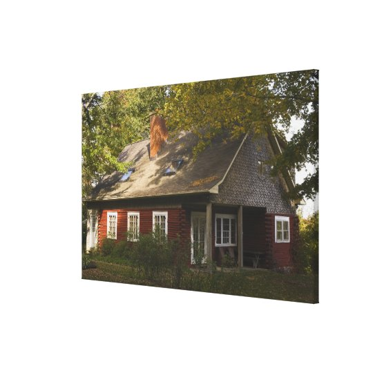 A Red Log Home Canvas Print