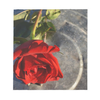 A red rose on a silver circled background left memo notepads