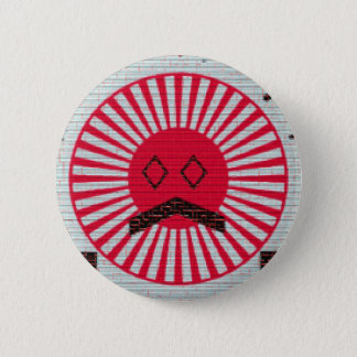 a red sun with eyes on a button