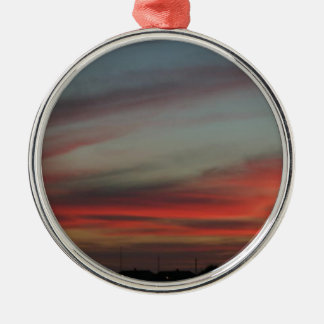 A Red Sunset over the Old City Round Metal Christmas Ornament