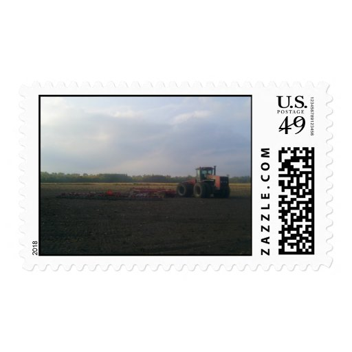 A Red Tractor Resting On The Open Fields... Postage Stamp
