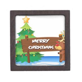 A reindeer hugging the wooden signboard for christ keepsake box