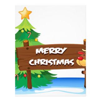 A reindeer hugging the wooden signboard for christ letterhead