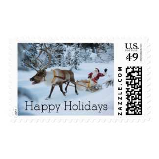A reindeer pulling Santa Claus and his sleigh Postage Stamp