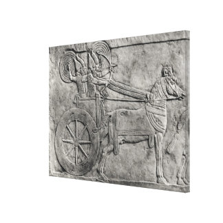 A relief depicting the Assyrian army in battle Canvas Print