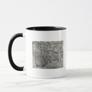 A relief depicting the Assyrian army in battle Mug