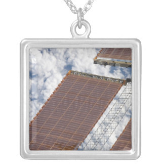 A repaired solar array silver plated necklace