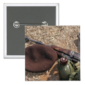 A rifle, military cover and canteen 2 inch square button
