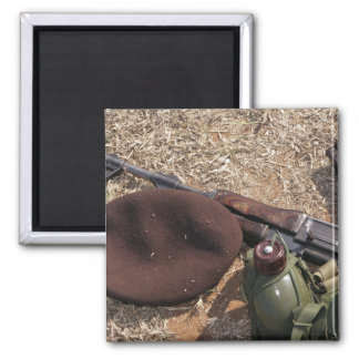 A rifle military cover and canteen fridge magnets