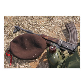 A rifle, military cover and canteen photo print